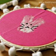 Craft: handprint bunny hoop art