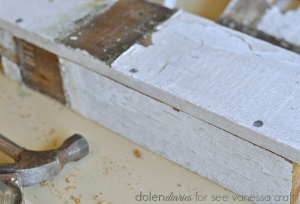 galvanized nails through the bottom of the utensil caddy
