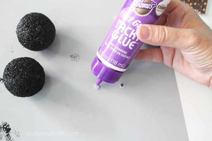 Glue-google-eyes-on-painted-foam-sphere