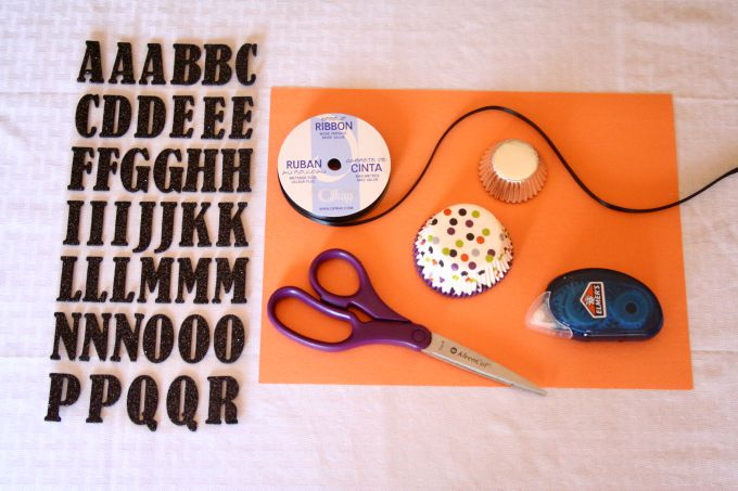 Materials needed to create a trick-or-treat paper banner.