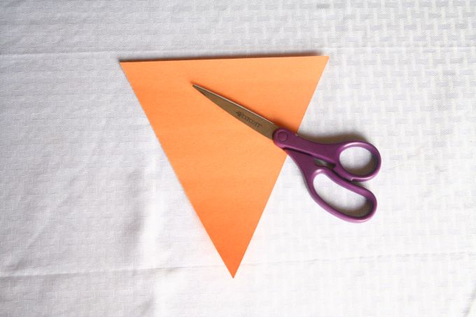 Second step to create a DIY paper Halloween banner.