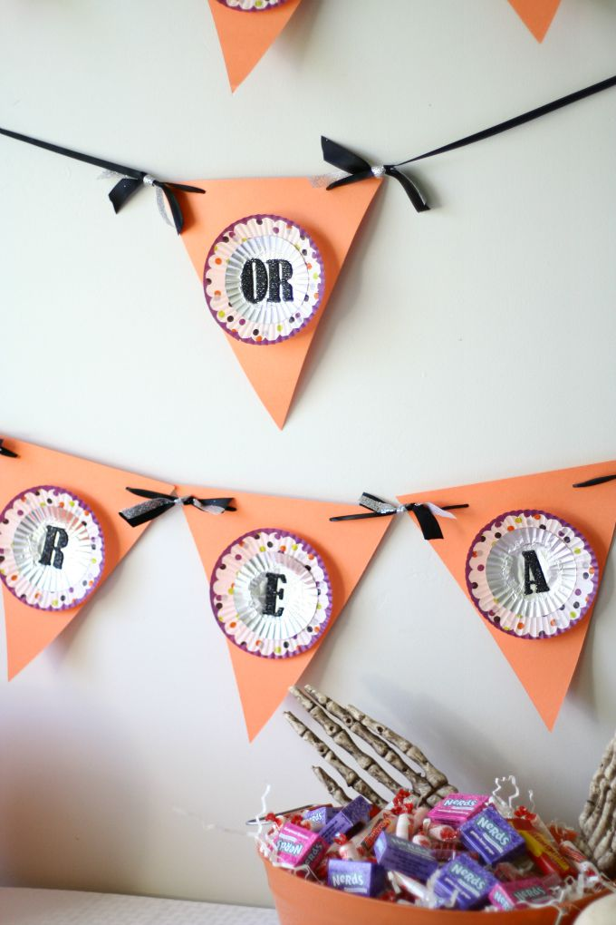 Halloween Trick-Or-Treat Banner - DIY using cupcake liners and adhesive letters
