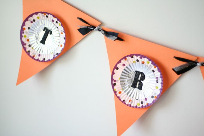 Cupcake liners used to make a festive Halloween banner.