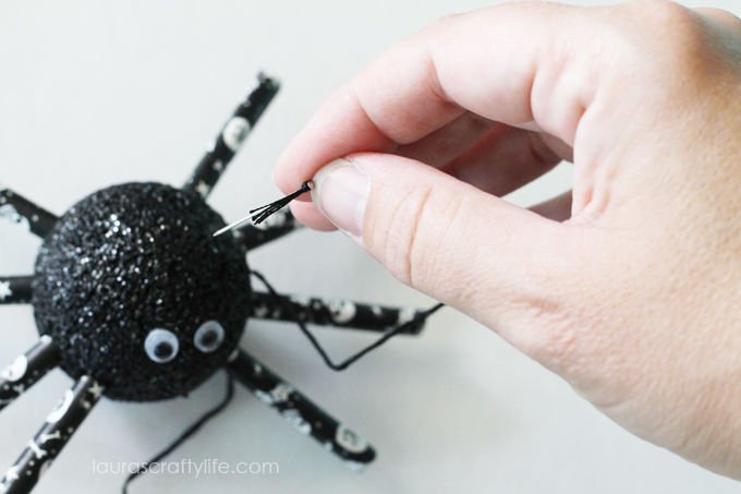 Use-a-pin-and-embroidery-floss-to-hang-spider