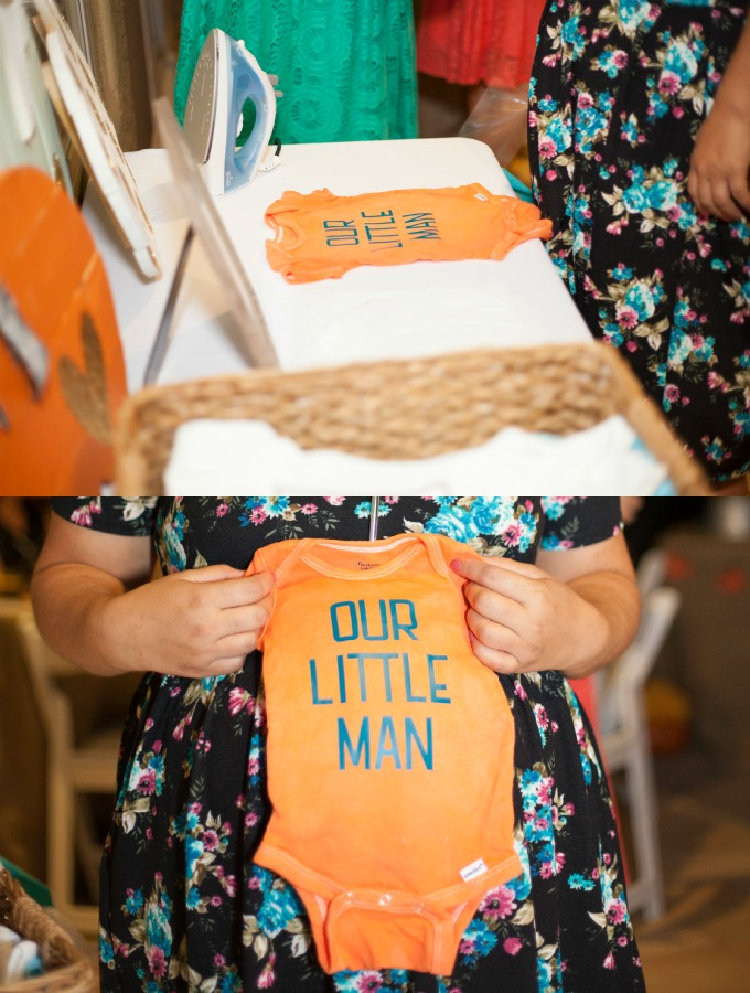 Personalized iron-on fabric onesie station for a baby shower.