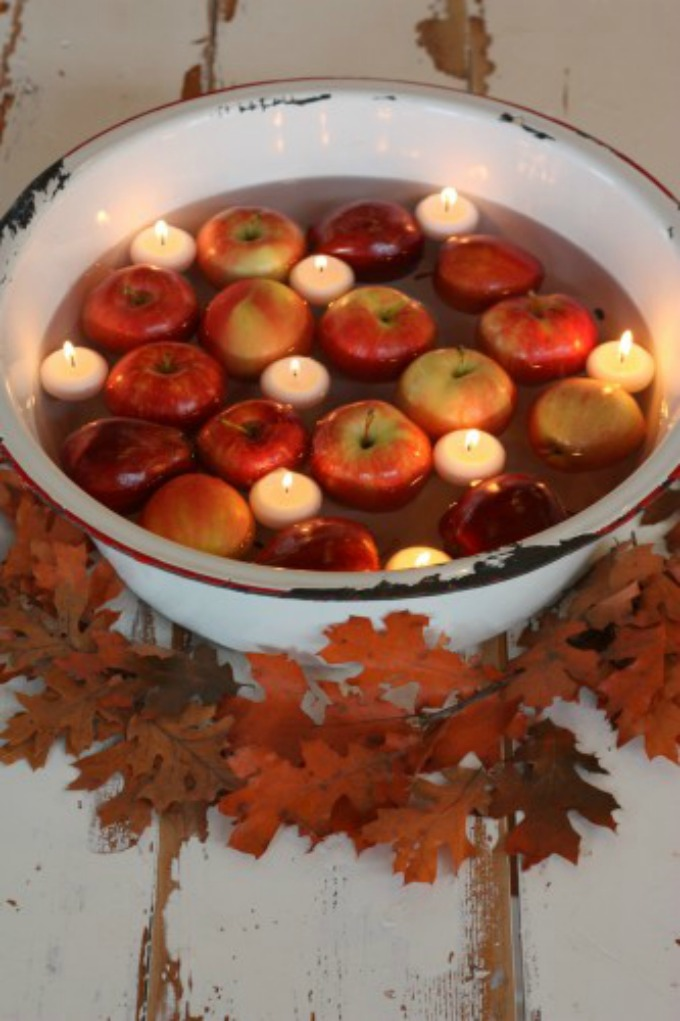 Vintage Thanksgiving table centerpiece with floating apples and candles