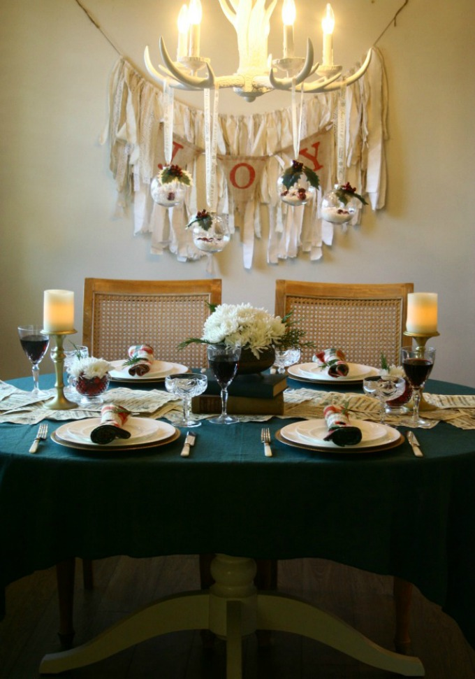 Holiday Party Table With Hanging Mistletoe Ornaments