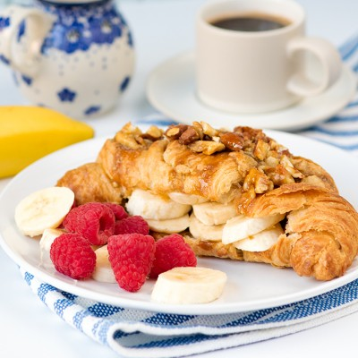 Sticky-Banana-croissants-with-crushed-nuts-square