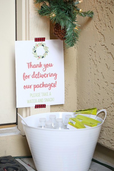 Leave a bucket of snacks out to say thank you to people delivery packages during the holidays!